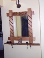 El espejo de la entrada
